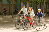 Couple with son on bicycles — ストック写真