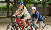 Family of three  riding bikes — Stock Photo