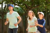 Sports family doing running outdoor  — ストック写真