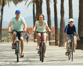 Couple with son on bicycles — Stock Photo
