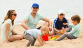 Parents with kids at seaside — Stock Photo