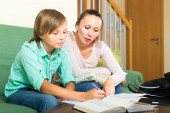 Schoolboy and mother doing homework — Stock Photo