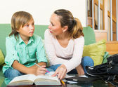 Mother with son doing homework — Stock Photo