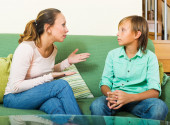 Serious   mother and  teen boy talking — Stock Photo