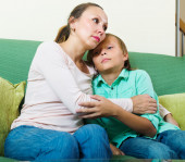 mother consoling sad teenage son  — Stock Photo