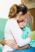 Mother consoling sad teenager   — Stock Photo