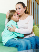 Mother comforting teenage boy — Stock Photo