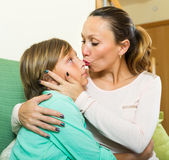 Woman consoling crying teenage son — Stock Photo