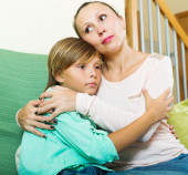 Calm woman consoling sad teenage son  — Stock Photo