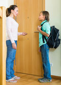 Mother with son at doorway — Stock Photo