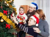 Happy family at new year time — Stock Photo