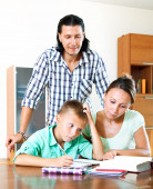 Parents helping with homework — Стоковое фото