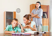 Parents  helping with homework — Stock Photo