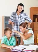 Parents berates  underachiever son — Stock Photo