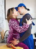 Woman having flirt with plumber — Stock fotografie