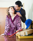 Smiling worker and housewife flirting — Stock Photo