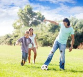 Happy parents with child playing with  ball — Stock Photo
