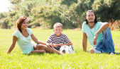 Couple with teenager child at city park — Stock Photo