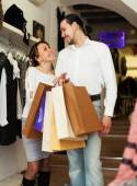 Family with bags at fasion store — Stock Photo