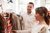 Family choosing clothes at boutique — Stock Photo
