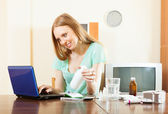 woman reading about medications in internet — Stock Photo