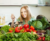 Woman cooking with heap of  vegetables — Stock Photo