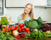 Woman with raw  vegetables — Stock Photo