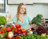Housewife with raw cabbage and other vegetables — Stock Photo