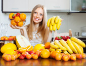 Positive   long-haired woman with bananas — Stock Photo