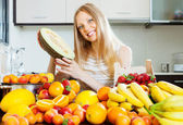 Happy blonde young woman holding melon   — Stock Photo