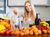 Girl making fruits beverages with wine — Stock Photo