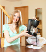 Smiling cute girl with new electric coffee maker — Stock Photo