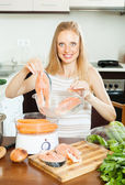 Woman cooking vegetables and salmon in  steamer — Stock Photo