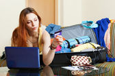 Woman reserving hotel online in the internet — Stock Photo
