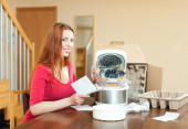 Woman with electric crock pot — Stock Photo