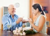 Elderly man with mature woman having romantic date — Stockfoto