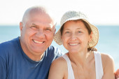 Mature couple together at sea beach — Stock Photo