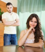 Young couple having serious talking in home — Stock Photo