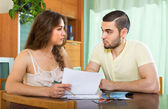 Couple with money and documents — Stock Photo