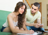 Young couple calculating budget — Stock Photo