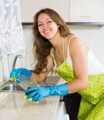 Housewife cleaning furniture in kitchen  — Stock Photo