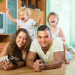 Family of four playing with kitten — Stock Photo #52540457
