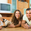 Family of four playing with kitten — Stock Photo #52540473
