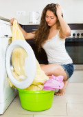 Girl near washing machine — Stock Photo