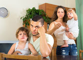 Man and woman quarreling at home — Stock Photo