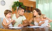 Parents with children having quarrel — Stock Photo