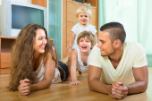 Happy family of four at home — Stock Photo
