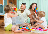 Happy family playing in home interior — Stock Photo