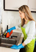 woman cleaning pipe with detergent   — Foto de Stock
