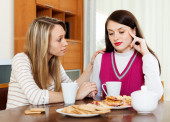 Young woman consoling the depressed woman   — Stock Photo